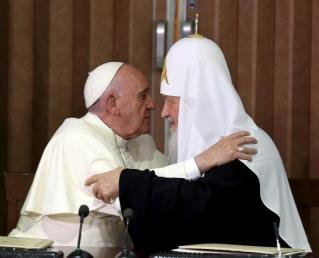 Pope Francis and Russian Orthodox Patriarch Kirill hug each other after signing agreements in Havana